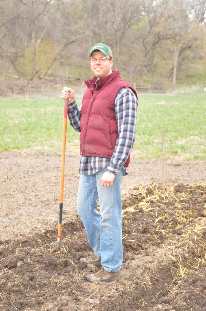 Erik helping to dig trenches for planting potatoes.